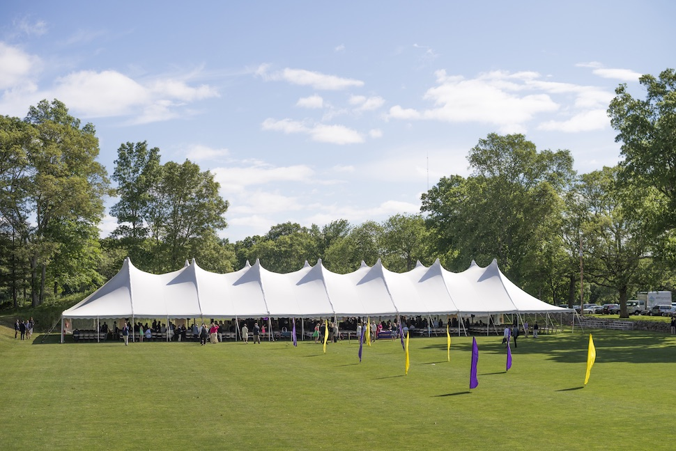 Graduation tent under blue skies at the Farm