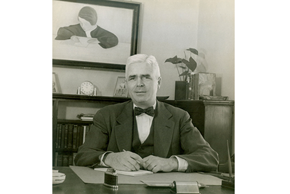 Fourth Head of School Rowland Morgan sits at his desk.