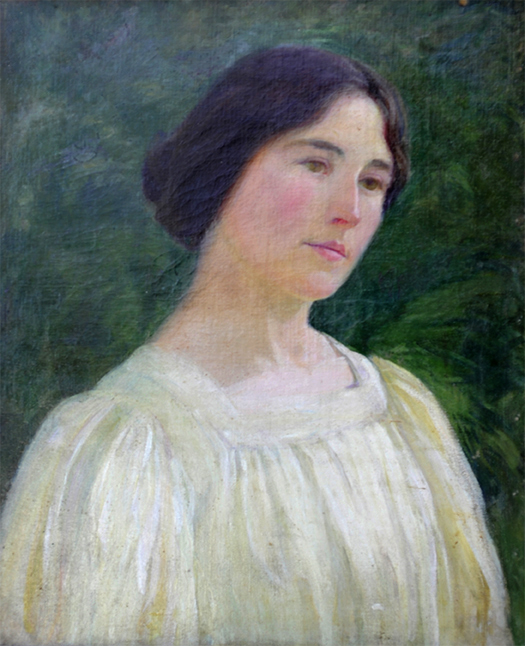 Portrait of a woman with dark hair.